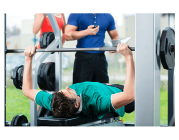 Bench pressing at the gym