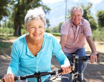 Man women ride bikes looking healthy